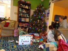 Christmas morning! (Our tree looks a little tipsy)